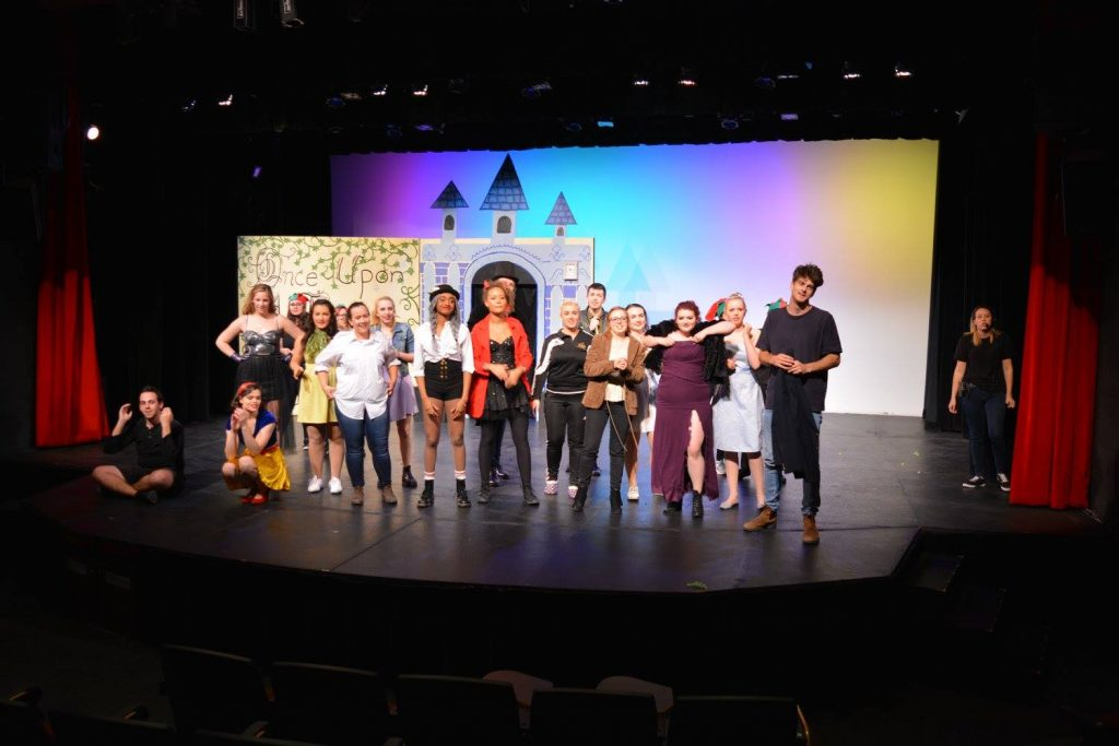 The cast of Brothers Grimm gathers onstage